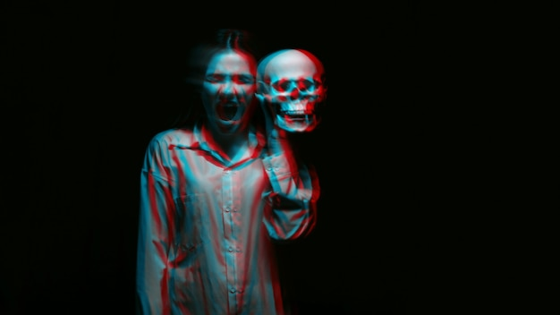 Blurry terrible portrait of a ghost witch girl with a dead man's skull in her hands on a dark background. black and white with 3d glitch virtual reality effect