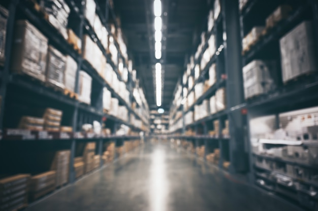 Blurry wall of warehouse inventory product stock for logistic, concept of international import and export shipment