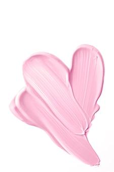 Румяна розовые красоты косметические текстуры изолированы на белом фоне размазанный макияж эмульсионный крем мазок ...