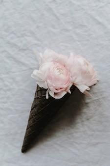 Blush ranunculus in a waffle cone