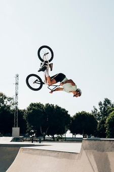 Bmx biker performing in the maximum velocity
