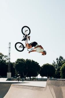 Bmx biker performing in the maximum velocity