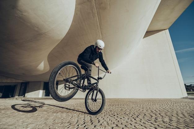 Bmx flatland rider doing a spin