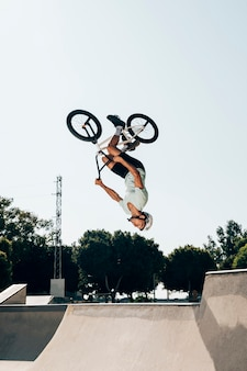 Bmx rider jumping upside-down
