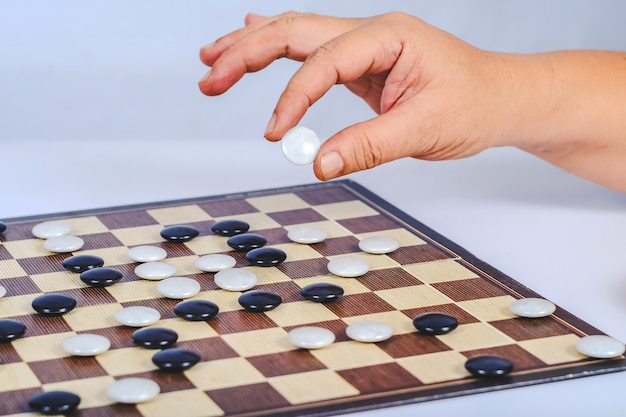 Board game go and black and white bones. go or wei-chi, asian board game.