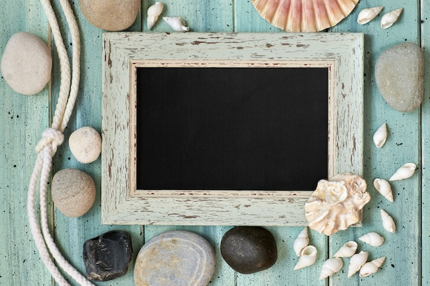 Board with maritime decorations on light turquoise wood, copy-space