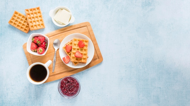 Board with waffles and fruits with copy-space