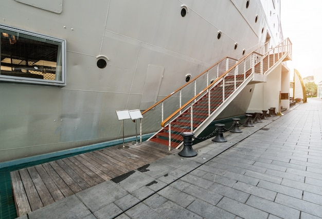 Boarding stairs, luxury yachts docked at the port