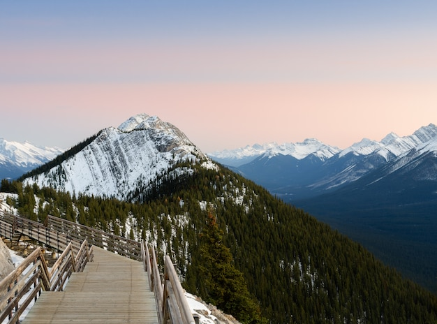 Boardwalk on sulphur mountain connecting gondola landing at sunset in banff, canada.  gondola ride to sulphur moutain overlooks the bow valley and the town of banff.