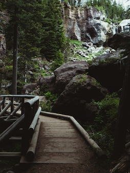Boardwalk through a park with rocks and boulders