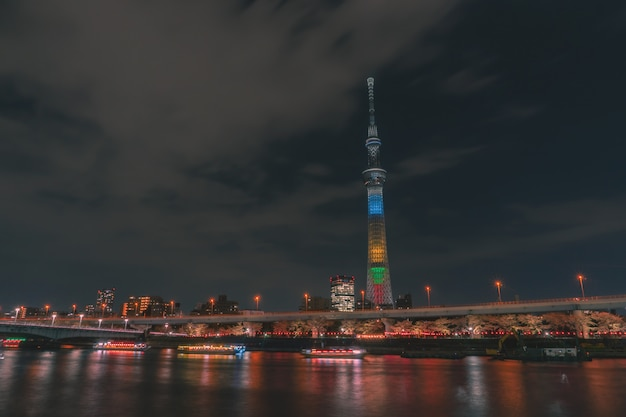 Boat are traveling in sumida river with tokyo skytree