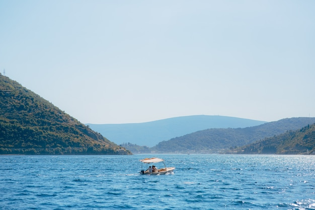 Boat in the bay of kotor. montenegro, the water of the adriatic sea. boats, yachts, liners.