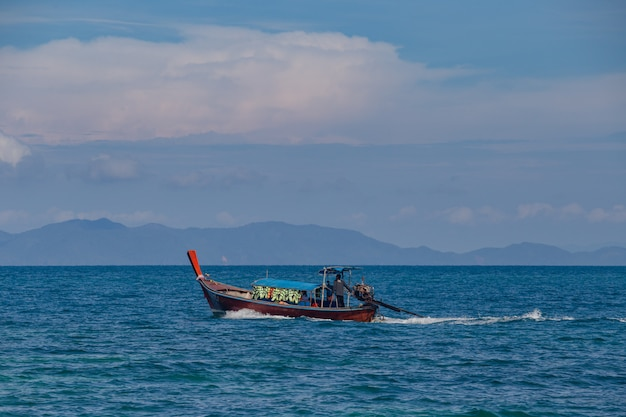 Boat and blue sky with sea