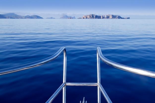 Boat bow in ibiza sailing to esparto island