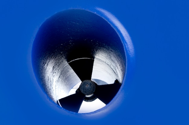 Boat bow thruster propeller detail painted in blue