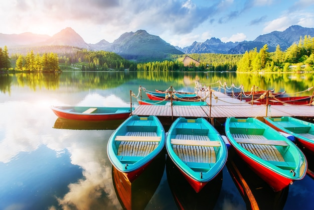 Boat on the dock surrounded mountains. fantastic shtrbske pleso high tatras. slovakia