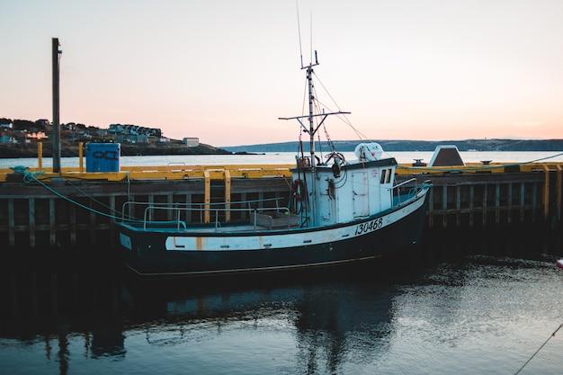 Boat on dock in water