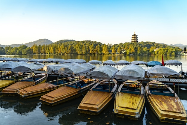 The boat docked at west lake border in hangzhou, china.