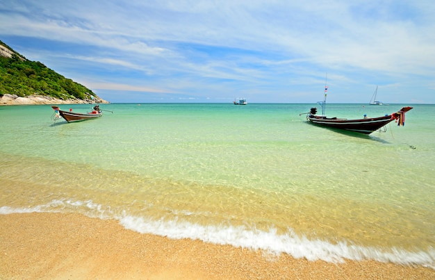 Boat floating on transparent water, tropical beach turquoise sea in thailand