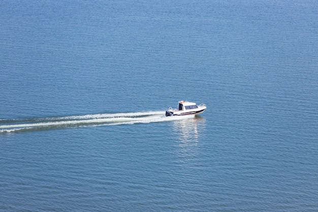 The boat floats at high speed.