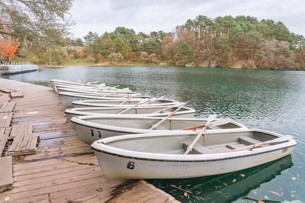 Boat on goshikinuma or five colored pond in autumn in fukushima prefecture, japan