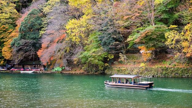Boat at katsura river in autumn, arashiyama