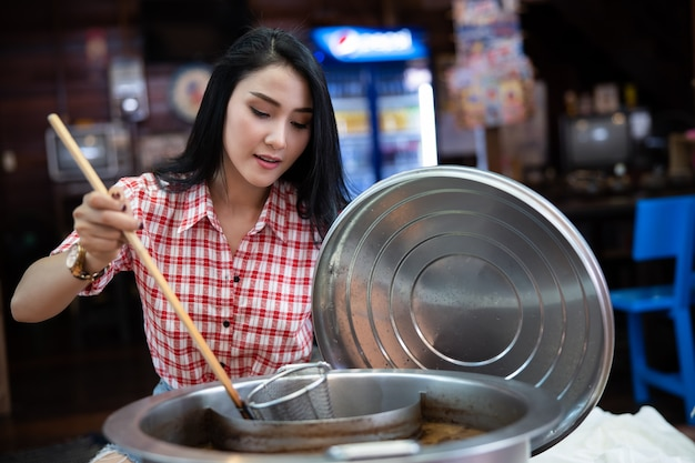 Boat noodle women thai style at amphawa thailand