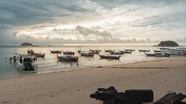 Boat parking on white sand beach lipe island at satun province thailand