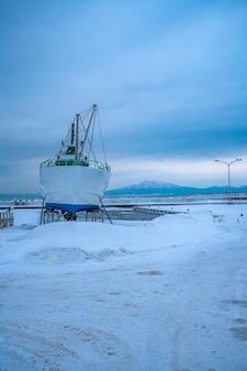 Boat on sea snow