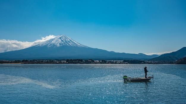 Boat on sea with fuji mountain view