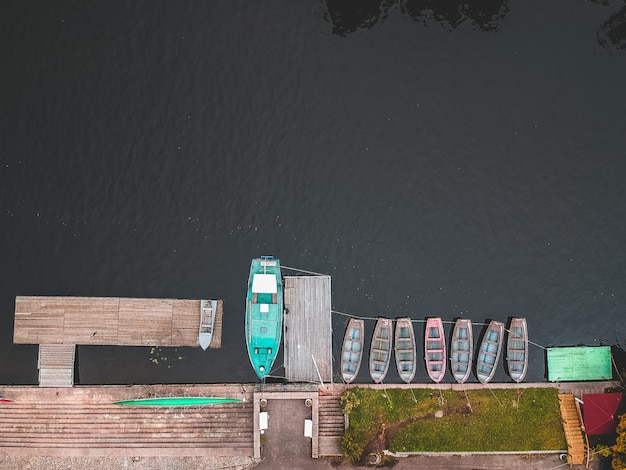 Boat station with pier, bill boats, kayaks and rowing.