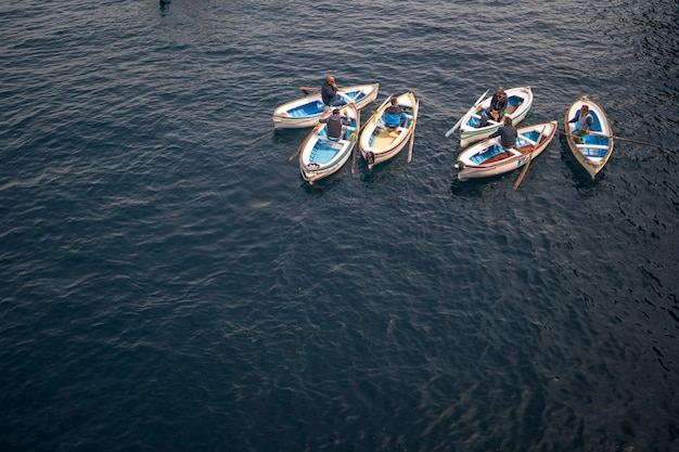 Boatmen at the entrance of blue grotto on capri island