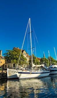 Boats on the channel at christianshavn in copenhagen, denmark