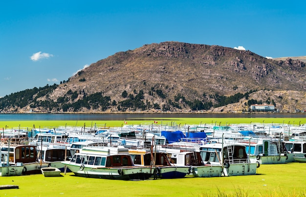 Boats docked at puno on lake titicaca in peru