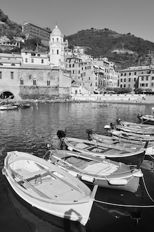 Boats in the harbour in vernazza, cinque terre, italy, black and white italian landscape