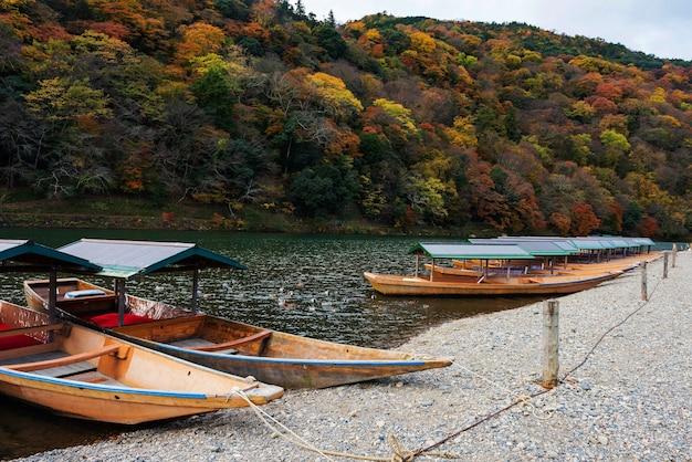 Boats on katsura river at fall, arashiyama