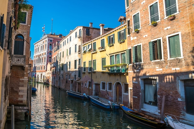 Boats in the narrow canals of venice, italy.