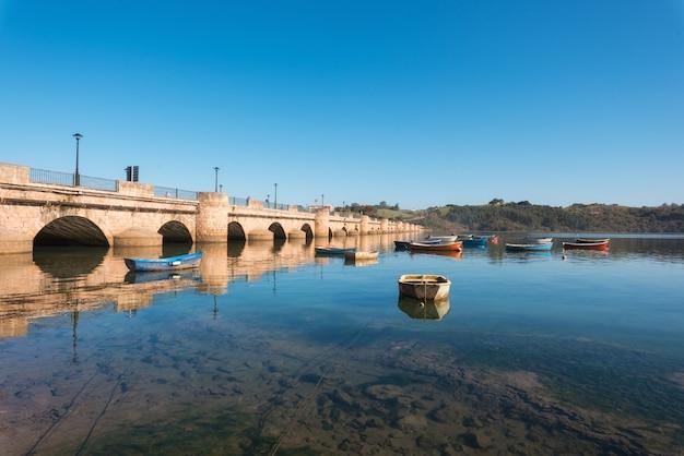 Boats in san vicente de la barquera, coastal village in cantabria, spain.