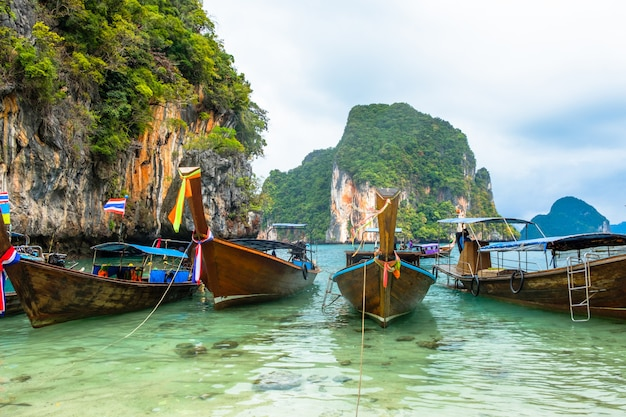 Boats in thai style on the of rocks in krabi province