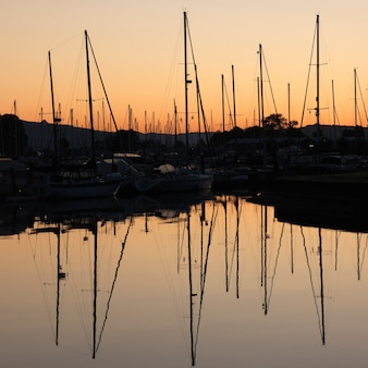 Boats with reflections at the marina in vancouver, british columbia, canada