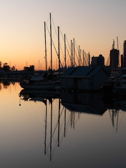 Boats with reflections in vancouver, british columbia, canada