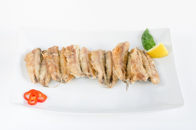 Bocartes or fried anchovies.