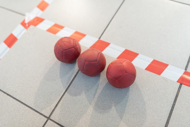 Boccia balls, red, on the field line. for any purpose.