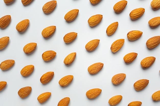 Body almond moisturizer on white background