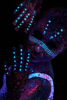 Body art on body posing in ultraviolet light