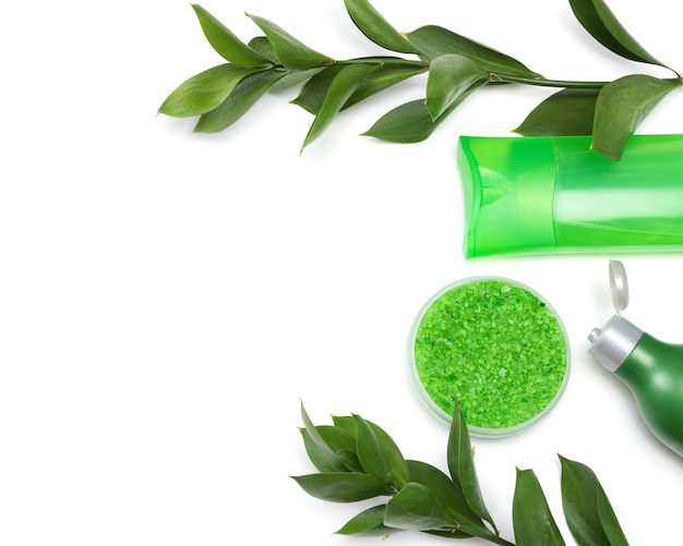 Body care products fresh green plant on white background natural cosmetics copy space