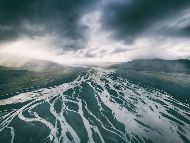 Body of water under black sky