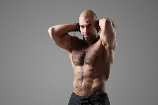 Bodybuilder posing and showing muscles
