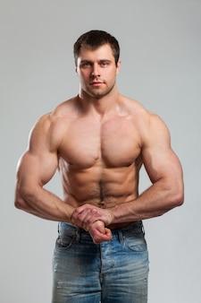 Bodybuilder shows his biceps
