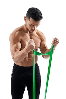 Bodybuilder training arms with resistance band.